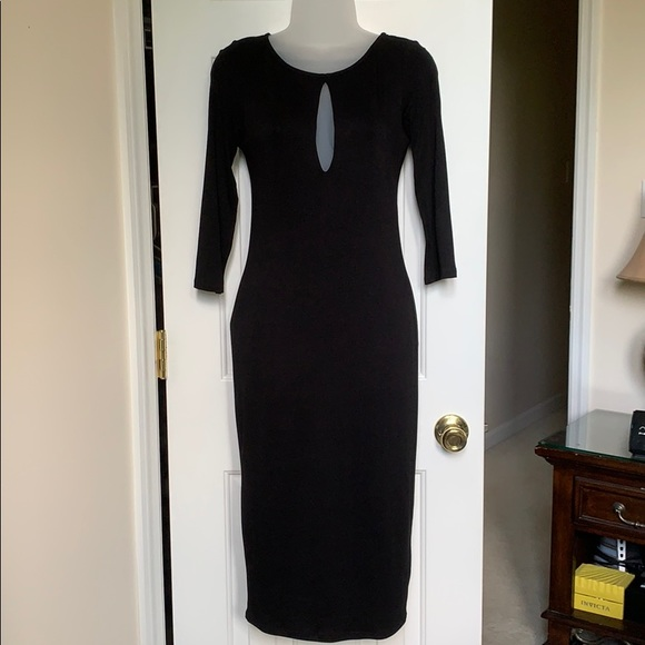 Sleek long lined black dress. NWOT